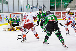 17.02.2015, Hala Tivoli, Ljubljana, SLO, EBEL, HDD Telemach Olimpija Ljubljana vs EC KAC, 4. Qualification Round, in picture Kim Strömberg (EC KAC, #17) vs Miika Wiikman (HDD Telemach Olimpija, #35) during the Erste Bank Icehockey League 4. Qualification Round between HDD Telemach Olimpija Ljubljana and EC KAC at the Hala Tivoli, Ljubljana, Slovenia on 2015/02/17. Photo by Morgan Kristan / Sportida