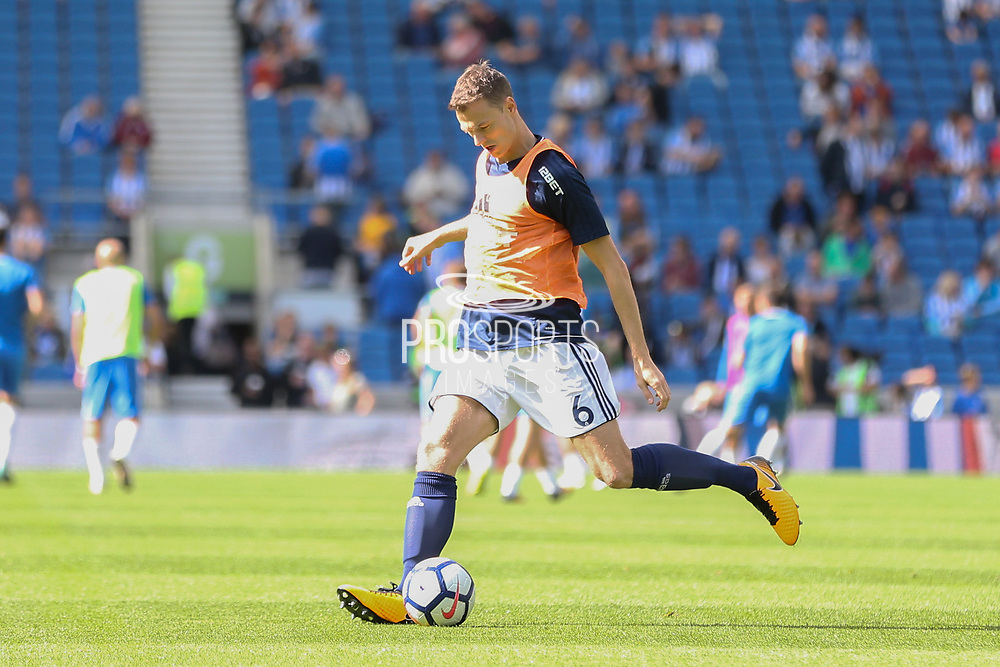 West Bromwich Albion defender Jonny Evans (6) in warm up during the Premier League match between Brighton and Hove Albion and West Bromwich Albion at the American Express Community Stadium, Brighton and Hove, England on 9 September 2017. Photo by Phil Duncan.