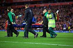 LIVERPOOL, ENGLAND - Wednesday, September 23, 2015: Liverpool's Dejan Lovren is carried off injured during the Football League Cup 3rd Round match against Carlisle United at Anfield. (Pic by David Rawcliffe/Propaganda)