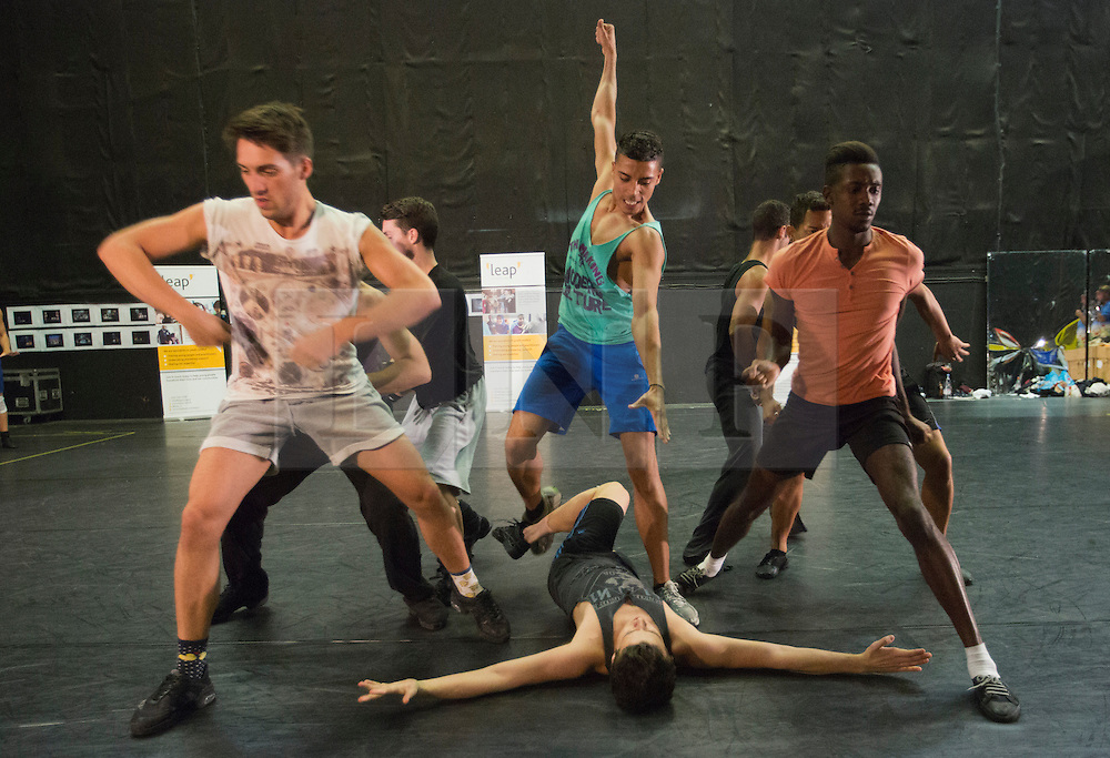 """© Licensed to London News Pictures. 29 August 2013. London, England. Pictured. Jet Boys and Shark Boys performing. Director and choreographer Joey McKneely and members of the UK cast of the musical """"West Side Story"""", currently playing at Sadler's Wells in London, held a workshop on gang violence with the youth charity """"Leap Confronting Conflict"""" for young Londoners from Leap's """"Quarrel Shop"""" programme at Three Mills Studios, London. During the workshop the young people watched the dancers perform the """"Rumble"""" scene and discussed the issues of gang violence and knife crime. Photo credit: Bettina Strenske/LNP"""