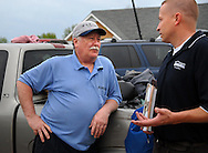 23 APRIL 2011 -- BRIDGETON, Mo. -- Terry Hayes (left) talks with claims adjustor John Buschjost of American Family Insurance April 23, 2011 about Hayes home, which was destroyed in a tornado that  Bridgeton, Mo. Friday night, April 22, 2011. Image © copyright 2011 Sid Hastings.