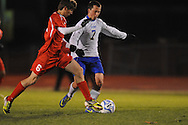 Oxford High's Ty Barber (7) vs. Lafayette High' Austin Fikes (6) in boys high school soccer action at Bobby Holcomb Field in Oxford, Miss. on Monday, December 10, 2012. Oxford won 8-0.