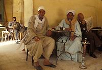 men smoking water pipes, Egypt