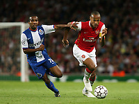Photo: Chris Ratcliffe.<br /> Arsenal v FC Porto. UEFA Champions League, Group G. 26/09/2006.<br /> Thierry Henry of Arsenal clashes with Paulo Assuncao of Porto.