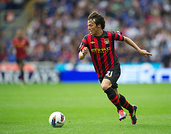 BOLTON, ENGLAND - Sunday, August 21, 2011: Manchester City's David Silva in action against Bolton Wanderers during the Premiership match at the Reebok Stadium. (Pic by David Rawcliffe/Propaganda)