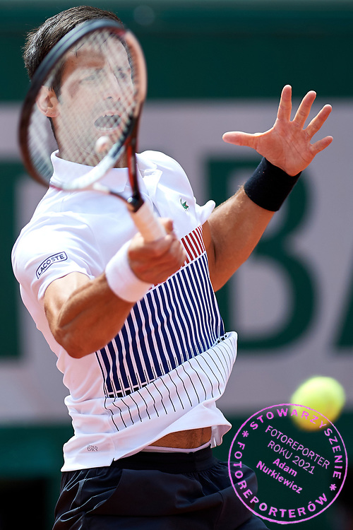 Paris, France - 2017 May 31: Novak Djokovic from Serbia plays a forehand while his men's single match second round during tennis Grand Slam tournament The French Open 2017 (also called Roland Garros) at Stade Roland Garros on May 31, 2017 in Paris, France.<br /> <br /> Mandatory credit:<br /> Photo by &copy; Adam Nurkiewicz<br /> <br /> Adam Nurkiewicz declares that he has no rights to the image of people at the photographs of his authorship.<br /> <br /> Picture also available in RAW (NEF) or TIFF format on special request.<br /> <br /> Any editorial, commercial or promotional use requires written permission from the author of image.