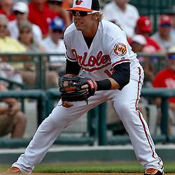 March 20, 2012; Sarasota, FL, USA; Baltimore Orioles third baseman Mark Reynolds (12) against the Philadelphia Phillies during a spring training game at Ed Smith Stadium.  Mandatory Credit: Derick E. Hingle-US PRESSWIRE