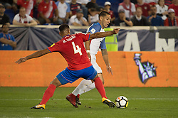 """September 1, 2017 - Harrison, New Jersey, U.S - Costa Rica defender MICHAEL UMA""""A (4) defends against USMNT forward CLINT DEMPSEY (8) during a World Cup qualifier match at Red Bull arena in Harrison, NJ.  Costa Rica defeats USA 2 to 0. (Credit Image: © Mark Smith via ZUMA Wire)"""