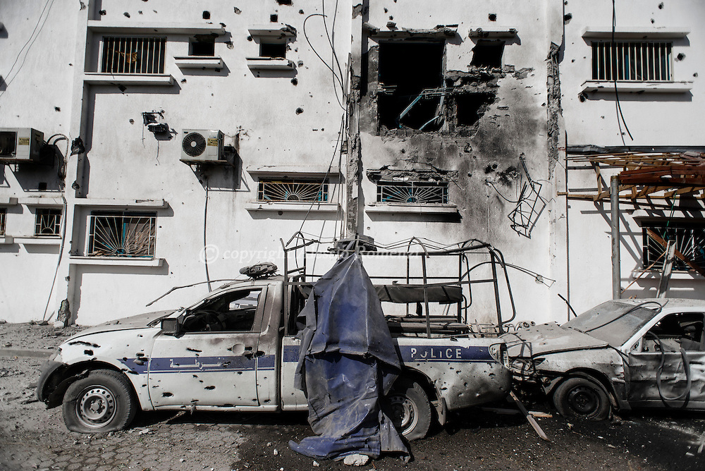 Gaza Strip, Beit Hanoun: A destroyed police car is seen in seen in the backyard of a damaged Beit Hanoun hospital on July 26, 2014. ALESSIO ROMENZI