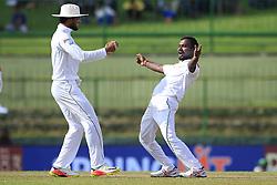 August 12, 2017 - Colombo, Sri Lanka - Sri Lankan cricketer Malinda Pushpakumara celebrates the dismissal of Indian batsman Ajinkya Rahane(unseen) with Sri Lankan cricket captain Dinesh Chandimal(L) during the 1st Day's play in the 3rd Test match between Sri Lanka and India at the Pallekele International cricket stadium, Kandy, Sri Lanka on Saturday 12 August 2017. (Credit Image: © Tharaka Basnayaka/NurPhoto via ZUMA Press)