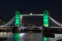 June 14, 2018 - London, London, UK - London, UK.  Tower Bridge in London is illuminated in green this evening to mark the one year anniversary since the Grenfell Tower fire which claimed 72 lives. (Credit Image: © Vickie Flores/London News Pictures via ZUMA Wire)