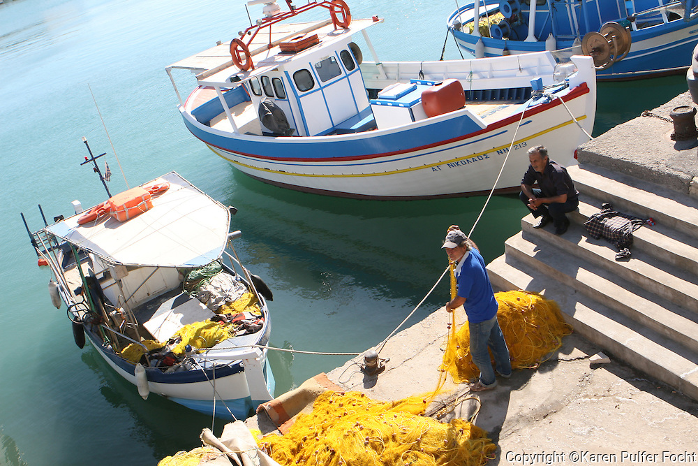 June 1, 2014 - Fisherman wrap it up for the day on the island of Crete in Greece.