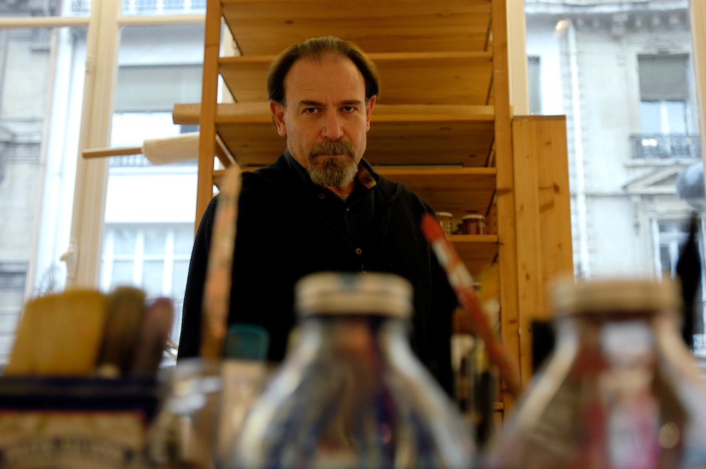 The italian artist Lorenzo Mattotti in his Paris studio. Mattotti's illustrations are internationally reknown and appear regularly in publications like The New Yorker, Vanity Fair, Le Monde, Paris Match, Panorama, The Face and many others. His work also appears in books, cinema, advertising and in exhibitions around the world. ..Paris, France. 06/12/2005..Photo © J.B. Russell