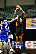 Heat Chaz Spicer takes a shot against Saints Reece Cassidy. 2009 NBL, Harbour Heat v Wellington Saints, North Shore Events Centre, Auckland. Thursday 26 March 2009. Photo: Anthony Au-Yeung/PHOTOSPORT