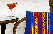 Tropical drink and locally made tapestries at Casa Sandra on Isla de Holbox, Mexico.