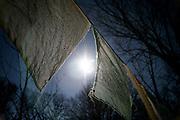 A row of Tibetan prayer flags blows in the breeze near St. John's Abbey in St. Cloud, Minnesota.