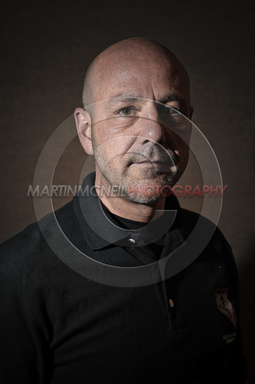 A portrait of mixed martial arts referee Yves Lavigne