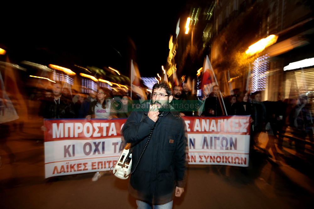 December 18, 2018 - Athens, Attica, Greece - Protest march by union members (PAME) in front of the Greek Parliament in Athens, Greece on December 18, 2018 as Greek Parliament gathers to vote on the 2019 budget. (Credit Image: © Giorgos Georgiou/NurPhoto via ZUMA Press)