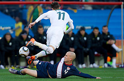 Milivoje Novakovic of Slovenia vs Michael Bradley of USA during the 2010 FIFA World Cup South Africa Group C match between Slovenia and USA at Ellis Park Stadium on June 18, 2010 in Johannesberg, South Africa. (Photo by Vid Ponikvar / Sportida)