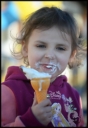 Yasmin Parsons 3, enjoys an Ice cream in the hot weather in Southend, United Kingdom. Sunday, 9th March 2014. Picture by Andrew Parsons / i-Images