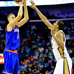 Mar 28, 2016; New Orleans, LA, USA; New York Knicks forward Kristaps Porzingis (6) shoots over New Orleans Pelicans center Alexis Ajinca (42) during the first quarter of a game at the Smoothie King Center. Mandatory Credit: Derick E. Hingle-USA TODAY Sports