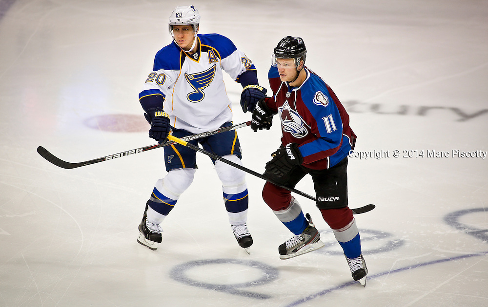 SHOT 3/8/14 2:04:47 PM - The Colorado Avalanche's Jamie McGinn #11 gets tangled up with the St. Louis Blues Alexander Steen #20 during their regular season Western Conference game at the Pepsi Center in Denver, Co. The Blues won the game 2-1.<br /> (Photo by Marc Piscotty / &copy; 2014)