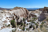 The Kasha-Katuwe Tent Rocks National Monument, New Mexico. The cone-shaped tent rock formations are the products of volcanic eruptions that occurred 6 to 7 million years ago and left pumice, ash and tuff deposits over 1,000 feet thick.