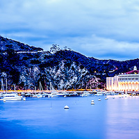 Catalina Island Avalon Bay at night panorama picture with the Catalina Avalon Casino, Pacific Ocean and mountains. Catalina Island is a popular destination off the coast of Southern California in the United States.