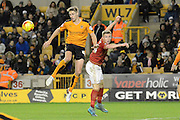 Wolverhampton Wanderers midfielder Dave Edwards wins the header during the Sky Bet Championship match between Wolverhampton Wanderers and Nottingham Forest at Molineux, Wolverhampton, England on 11 December 2015. Photo by Alan Franklin.