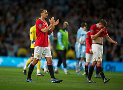 MANCHESTER, ENGLAND - Monday, April 30, 2012: Manchester United's Rio Ferdinand looks dejected at full-time following the Premiership match at the City of Manchester Stadium. (Pic by Chris Brunskill/Propaganda)