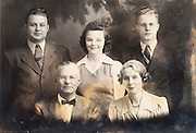 deteriorating vintage photo of a family group portrait
