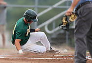 West's Reid Bonner (15) slides into home for the first run of the game during their substate baseball game at Iowa City West High School in Iowa City on Friday evening, July 13, 2012. West defeated Washington 6-0.