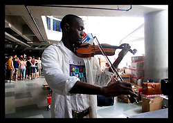 31st August, 2005. 'Hell on earth.' The Superdome in New Orleans, Louisiana where over 20,000 refugees from hurricane Katrina are crammed into hellish conditions. In a bizarre moment Samuel Thompson plays a last lament for New Orleans.
