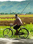 Burmese farmer on a bike