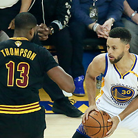 04 June 2017: Cleveland Cavaliers center Tristan Thompson (13) defends on Golden State Warriors guard Stephen Curry (30) during the Golden State Warriors 132-113 victory over the Cleveland Cavaliers, in game 2 of the 2017 NBA Finals, at the Oracle Arena, Oakland, California, USA.