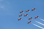 Canadian Forces Snowbirds in a Big Arrow formation with smoke.  The Snowbirds are also known as the 431 Air Demonstration Squadron and fly the Canadair CT-114 Tutor jet. Photographed during the Canada 150 celebrations in White Rock, British Columbia, Canada.