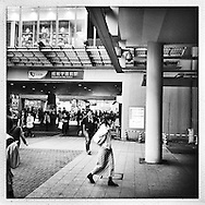 Police surveillance camera vigilantly watches over an entrance to this Tokyo periphery station.  Tokyo, Japan.