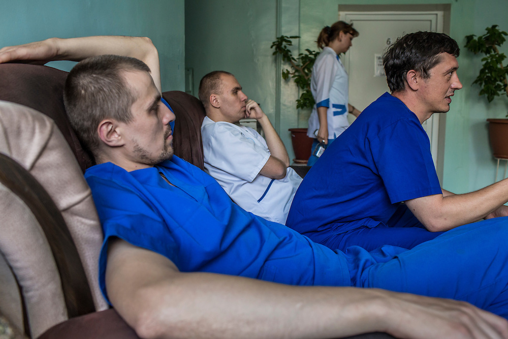 BAKHMUT, UKRAINE - JULY 10, 2016: Doctors at the main city hospital discuss casualties resulting from fighting in Bakhmut, Ukraine. Many casualties from nearby fighting pass through the hospital on the way to better-equipped hospitals further away. CREDIT: Brendan Hoffman for The New York Times