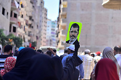 19.03.2014, Giza, EGY, Ausschreitungen in Ägypten, im Bild Proteste gegen das Todesurteil von EX Präsident Mohammed Mursi // Egyptian supporters of Muslim Brotherhood take part in a demonstration to mark Friday's second anniversary of the military's overthrow of Islamist President Mohammed Morsi, Egypt on 2014/03/19. EXPA Pictures © 2015, PhotoCredit: EXPA/ APAimages/ Amr Sayed<br /> <br /> *****ATTENTION - for AUT, GER, SUI, ITA, POL, CRO, SRB only*****