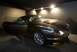 © Licensed to London News Pictures. 28/09/2012. LONDON, UK. An Aston Martin DBS used in the Bond film  'Quantum of Solace' (2008) (est. £1000,000-150,000) at the press view for the 50 Years of James Bond Auction in London today (28/09/12).  The auction, taking place on in two parts, an online sale on the 28th of September and an evening event on the 5th of October - Global James Bond Day -  is being held in aid of various charities and features props and costumes from 50 years of James Bond movies. Photo credit: Matt Cetti-Roberts/LNP