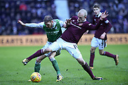 New signing 14 Steven Naismith puts pressure on 17 Martin Boyle  during the William Hill Scottish Cup 4th round match between Heart of Midlothian and Hibernian at Tynecastle Stadium, Gorgie, Scotland on 21 January 2018. Photo by Kevin Murray.