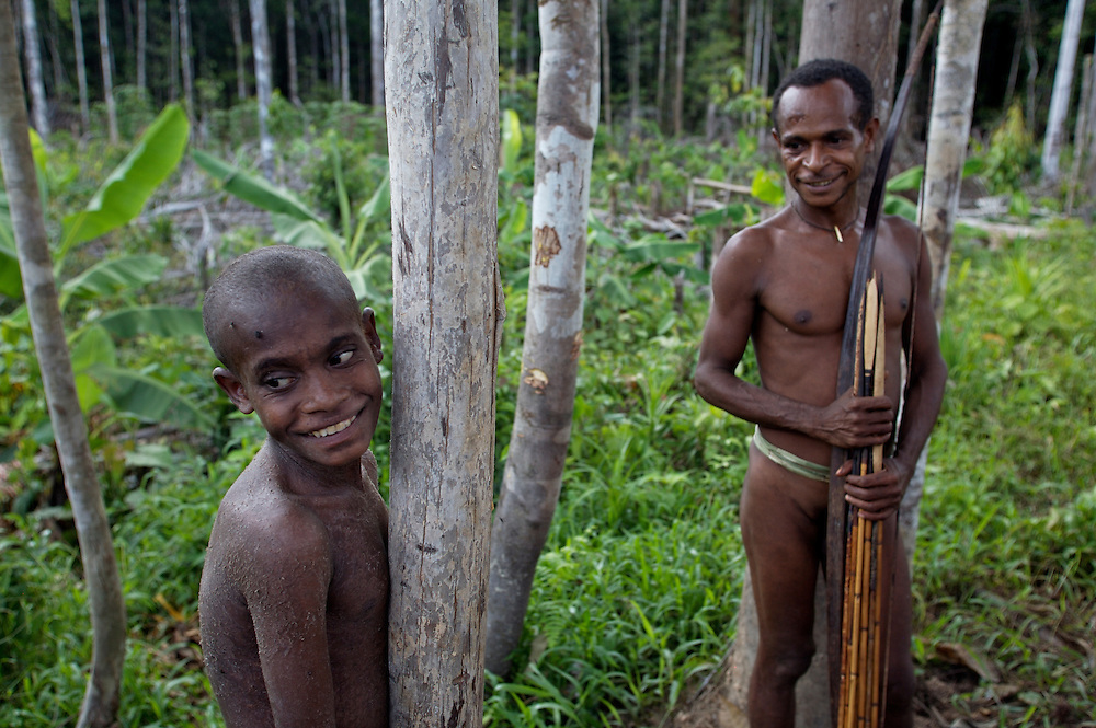 Kombai boy out hunting with his father. West Papua is home to over 300 tribes. They have inhabited the island for more than 40,000 years. Many of the last remaining tribal cultures on our planet can be found in West Papua. An astounding 15% of the world's languages are spoken there, by just 0.01% of the global population.