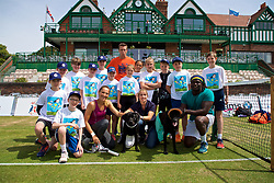 LIVERPOOL, ENGLAND - Saturday, June 23, 2018: Two Labrador Honorary ball girls pose for a photograph with Robert Kendrick (USA), Alexandra Cadantu (ROU) Tennis coach Sam Jolloh, Kate Finlay, Kates Doggy Boutique and  tournament ball boys and ball girls during day three of the Williams BMW Liverpool International Tennis Tournament 2018 at Aigburth Cricket Club. (Pic by Paul Greenwood/Propaganda)