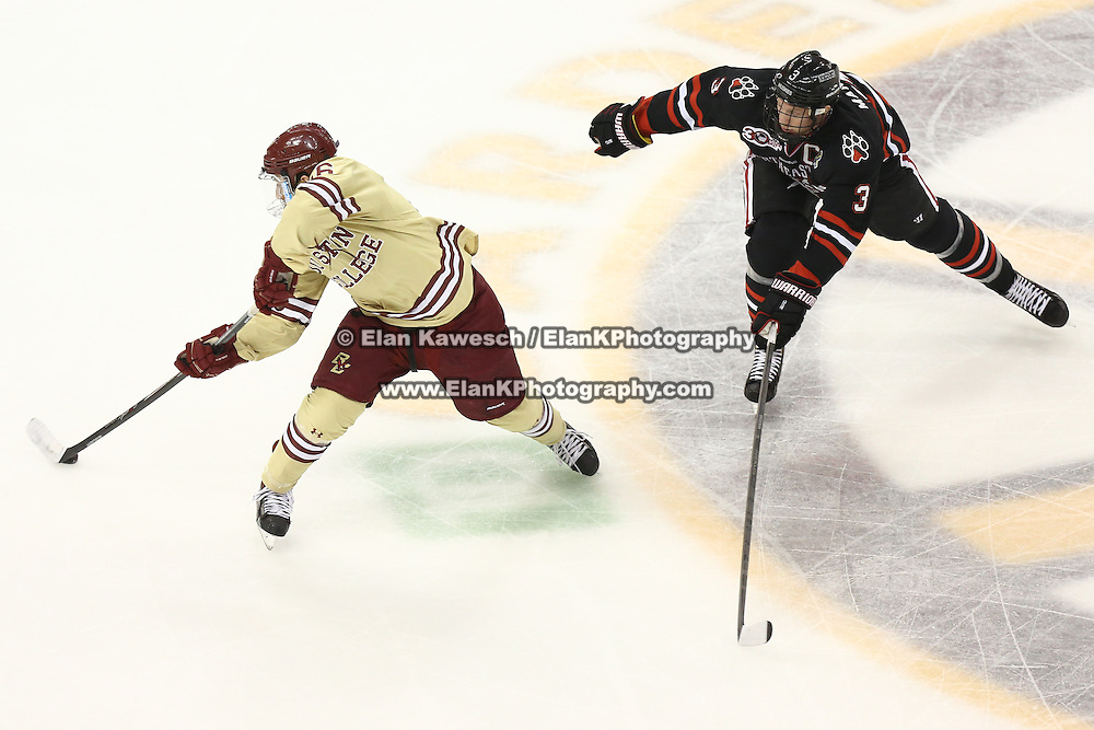 Austin Cangelosi #26 of the Boston College Eagles keeps the puck from Josh Manson #3 of the Northeastern Huskies during The Beanpot Championship Game at TD Garden on February 10, 2014 in Boston, Massachusetts. (Photo by Elan Kawesch)