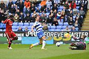Early chance on goal for Reading FC striker Yann Kermorgant blocked by Cardiff City goalkeeper Simon Moore during the Sky Bet Championship match between Reading and Cardiff City at the Madejski Stadium, Reading, England on 19 March 2016. Photo by Mark Davies.