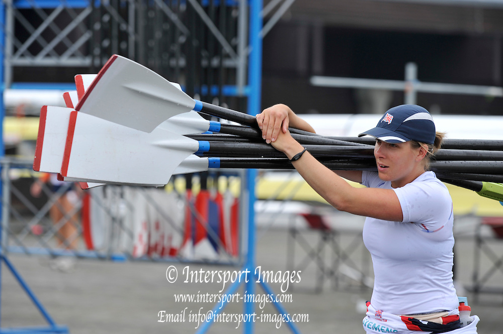 Munich, GERMANY,   GBR W4X, Beth RODFORD carries the Sculls/Blades/oars back to the boathouse after a morning training session.  Thursday  17/06/2010. 2010 FISA World Cup.   [Mandatory Credit Peter Spurrier/ Intersport Images]