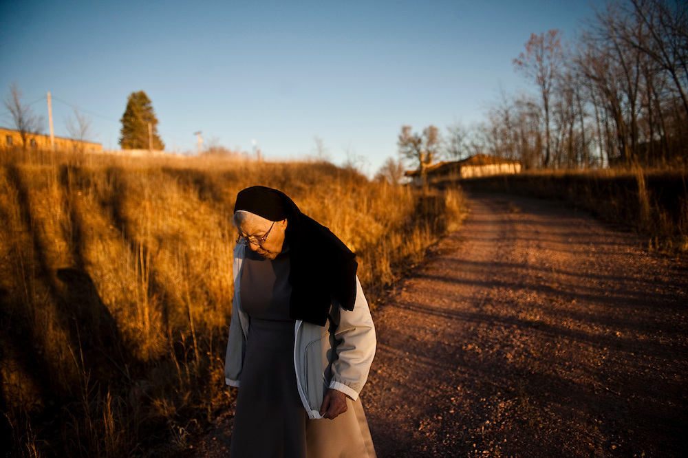 Sister Agnes walks a path behind the nun's home as the sun sets over Winnebago Nov. 14, 2013. Photo by Lauren Justice