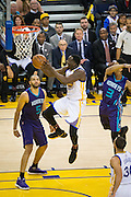 Golden State Warriors forward Draymond Green (23) takes the ball to the basket against the Charlotte Hornets at Oracle Arena in Oakland, Calif., on February 1, 2017. (Stan Olszewski/Special to S.F. Examiner)