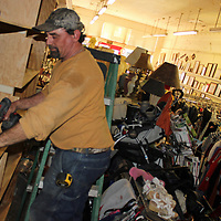 RAY VAN DUSEN/BUY AT PHOTOS.MONROECOUNTYJOURNAL.COM<br /> Michael Jones installs shelves at the Friends of the Aberdeen Animal Shelter Thrift Store, which is undergoing a renovation to open up the space. Proceeds help provide for expenses of shelter pets.