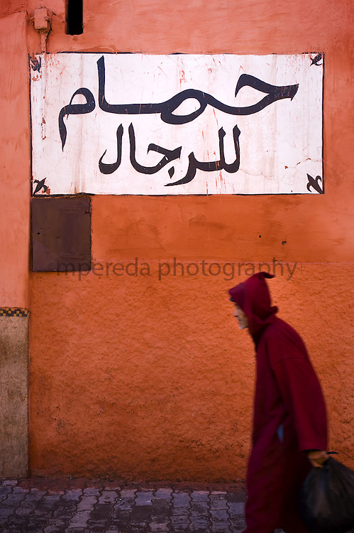 Old man walking in the streets of Marrakech